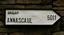 Irish road sign pointing to the area of Anagap in the parish of Annascaul in County Kerry, the mileage reflects the distance in a straight line from San Francisco to Anagap
