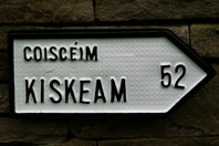 Irish Road sign for Kiskeam (Coisceim) village in County Cork