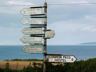 Multiple old style cast road signs on 1 post, click to enlarge.